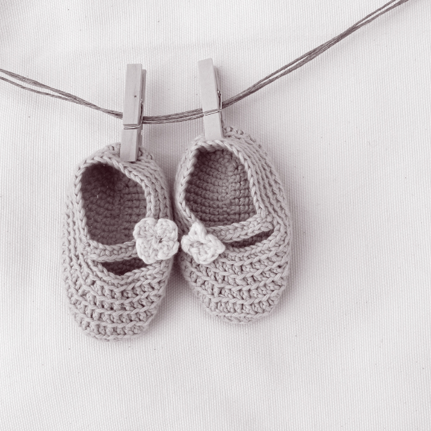 Crochet baby shoes on a washing line