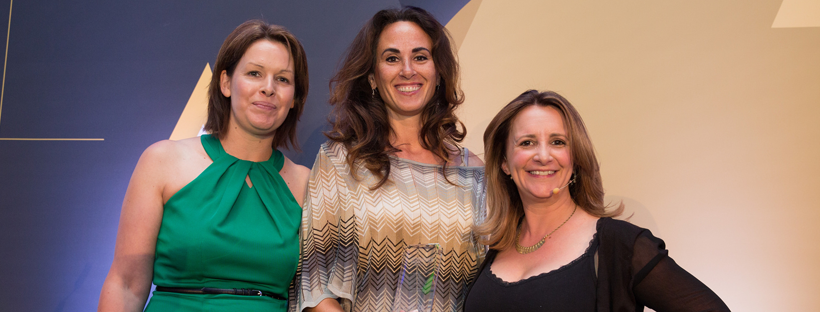 Winner Amber Vodegel (centre) with Anouska Ramsay from Capgemini UK (L) and host Lucy Porter (R)