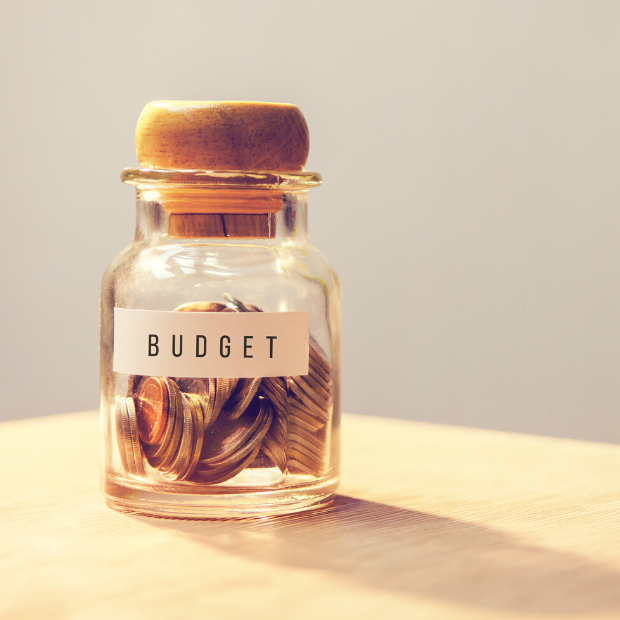 Penny jar labelled with the word budget